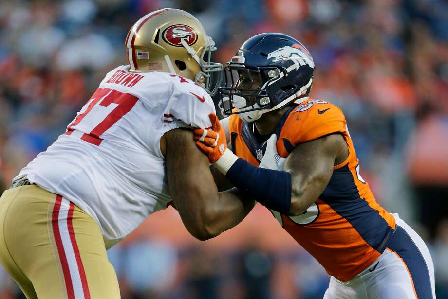 """Denver Broncos linebacker Von Miller (right) says of 49ers offensive tackle Trent Brown: """"There's not another tackle who's that tall, that big and can move he way he moves."""" Photo: Jack Dempsey, Associated Press"""