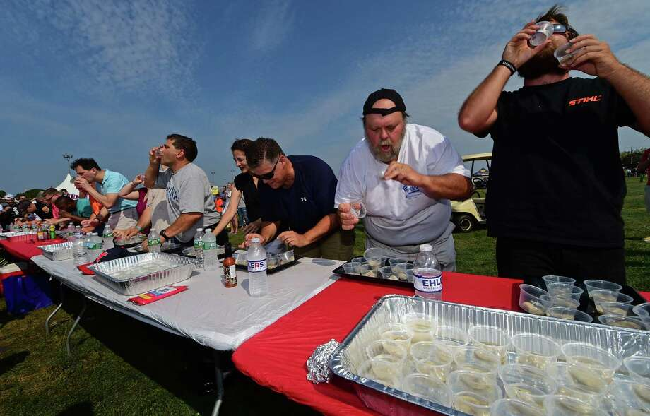 Doug Hempstead, second from right, and Colton Harmon, compete in the Slurp Off! during the 39th annual Norwalk Oyster Festival at Veterans Memorial Park Saturday, September 10, 2016, in Norwalk, Conn. Photo: Erik Trautmann / Hearst Connecticut Media / Norwalk Hour