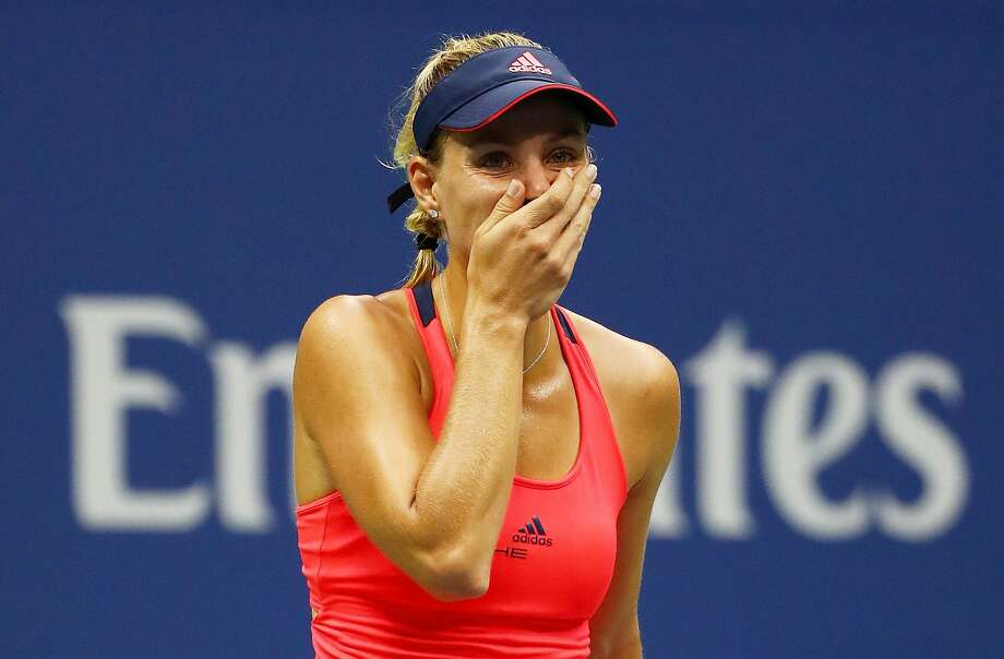 Angelique Kerber is just beginning to grasp she is a U.S. Open champion for the first time just seconds after beating Karolina Pliskova. Photo: Al Bello, Getty Images