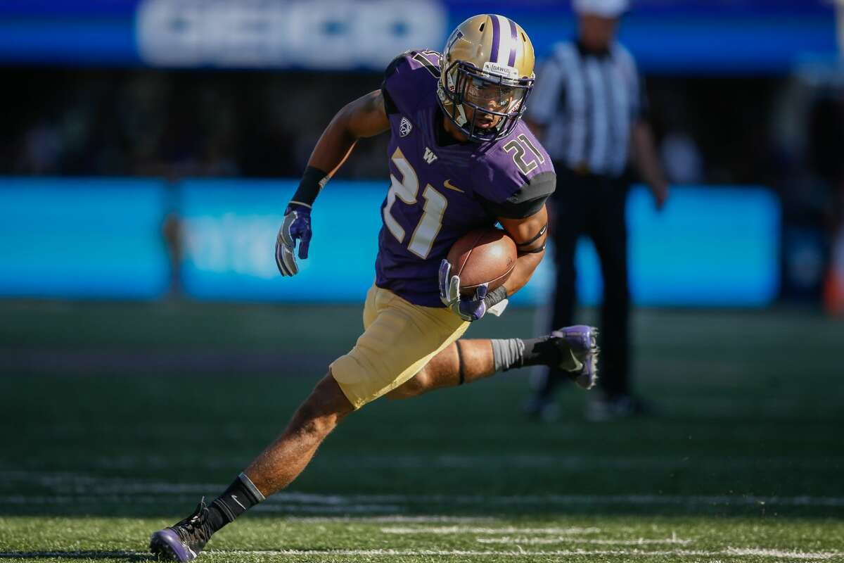 Wide receiver Quinten Pounds #21 of the Washington Huskies rushes against the Idaho Vandals on September 10, 2016 at Husky Stadium in Seattle, Washington. (Photo by Otto Greule Jr/Getty Images)