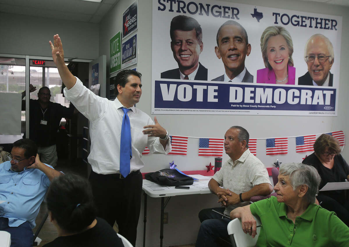 Bexar County Democratic Party Chairman Manuel Medina instructs volunteers in a recent phone bank effort to reach potential voters.