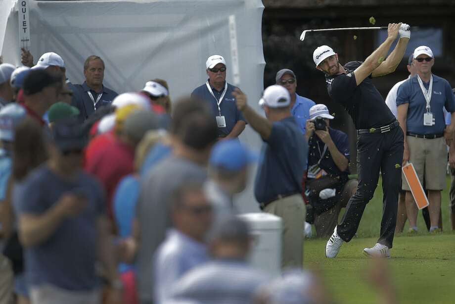 Dustin Johnson drives off the tee of the sixth hole during the third round of the BMW Championship at Crooked Stick Golf Club near Indianapolis. Photo: AJ Mast, Associated Press