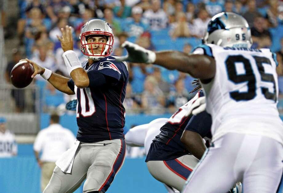 c2bc539c6 ... New England Patriots Jimmy Garoppolo (10) looks to pass under pressure  from Carolina ...