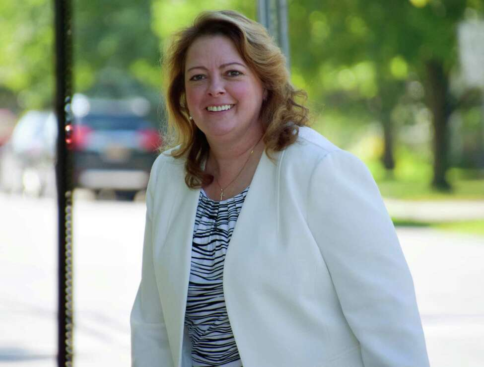 St. Lawrence County District Attorney Mary Rain walks near the St. Lawrence County Courthouse on Tuesday, Sept. 6, 2016, in Canton, N.Y. The trial of the former college soccer coach Oral