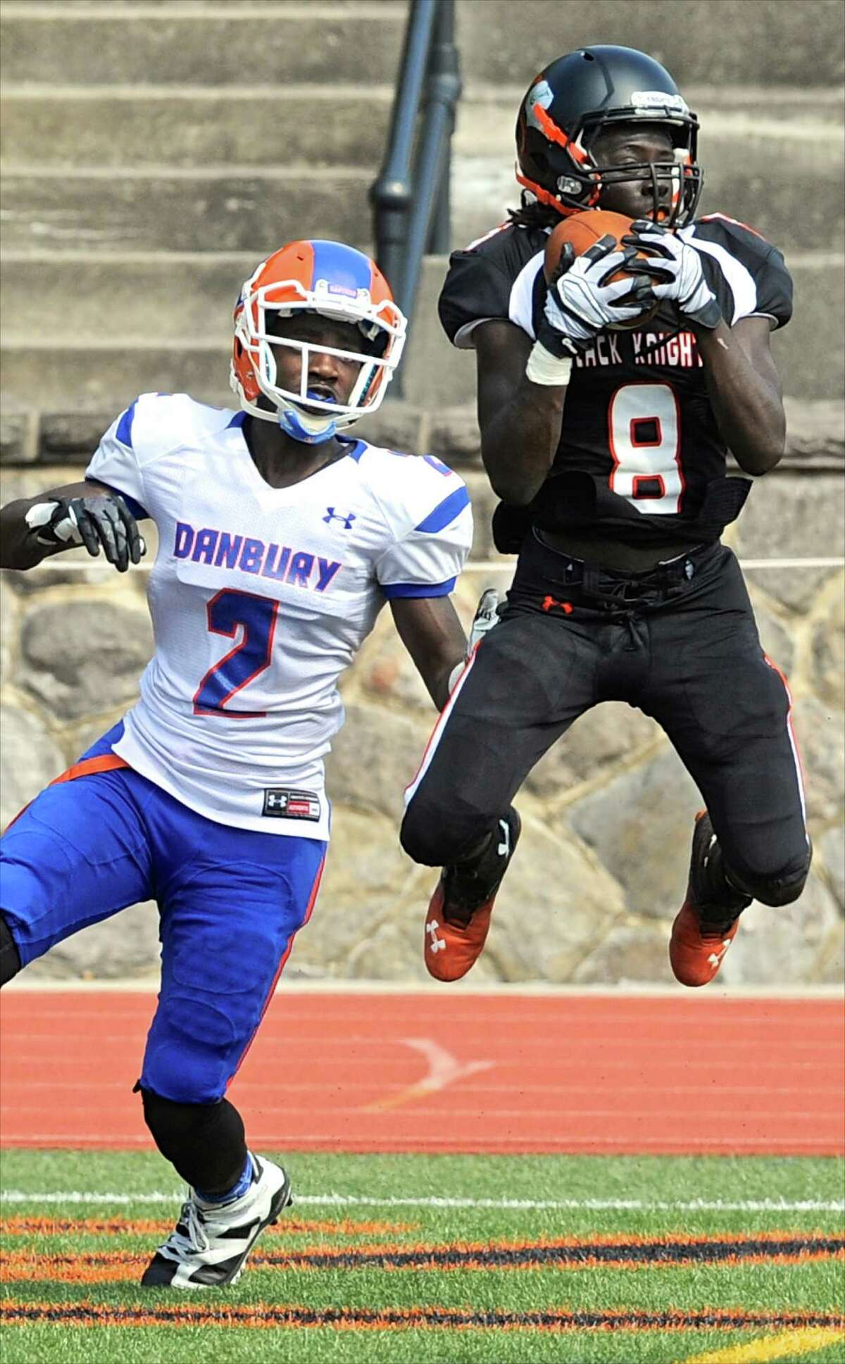 Stamford's Charles Razor (8) intercepts a pass intended for Danbury's Massiah Crandell (2) in the end zone in the high school football game between Danbury and Stamford high schools, Saturday afternoon, September 10, 2016, at Stamford High School, Stamford, Conn.
