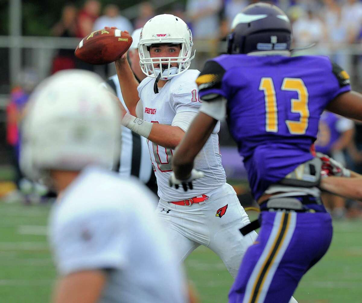 Greenwich quarterback Connor Langan throws to receiver Anthony Ferraro for a two point conversion against Westhill in the two teams season opener in the FCIAC conference at Westhill High School J. Walter Kennedy Stadium on Saturday, Sept.9, 2016. Greenwich defeated Westhill 22-16.