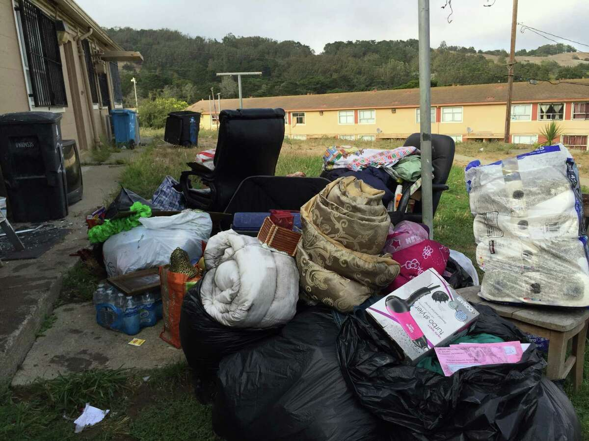 Belongings were gathered behind a Visitacion Valley apartment following a fire Saturday.