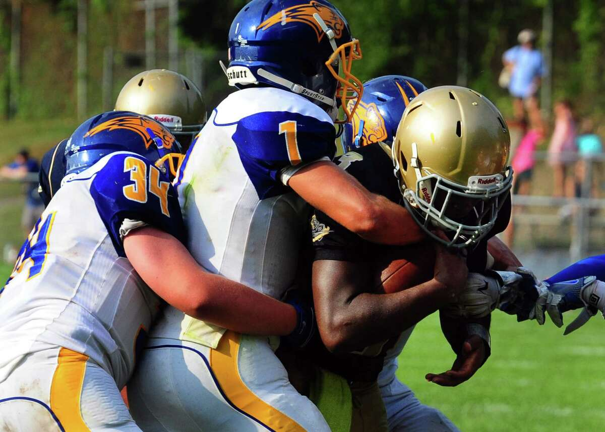 In the final moments of the game, Notre Dame of Fairfield's Taevian Jackson is stopped near the endzone by Brookfield preventing Notre Dame from an upset during football action in Fairfield, Conn. on Saturday Sept. 10, 2016. Final score 17-14.