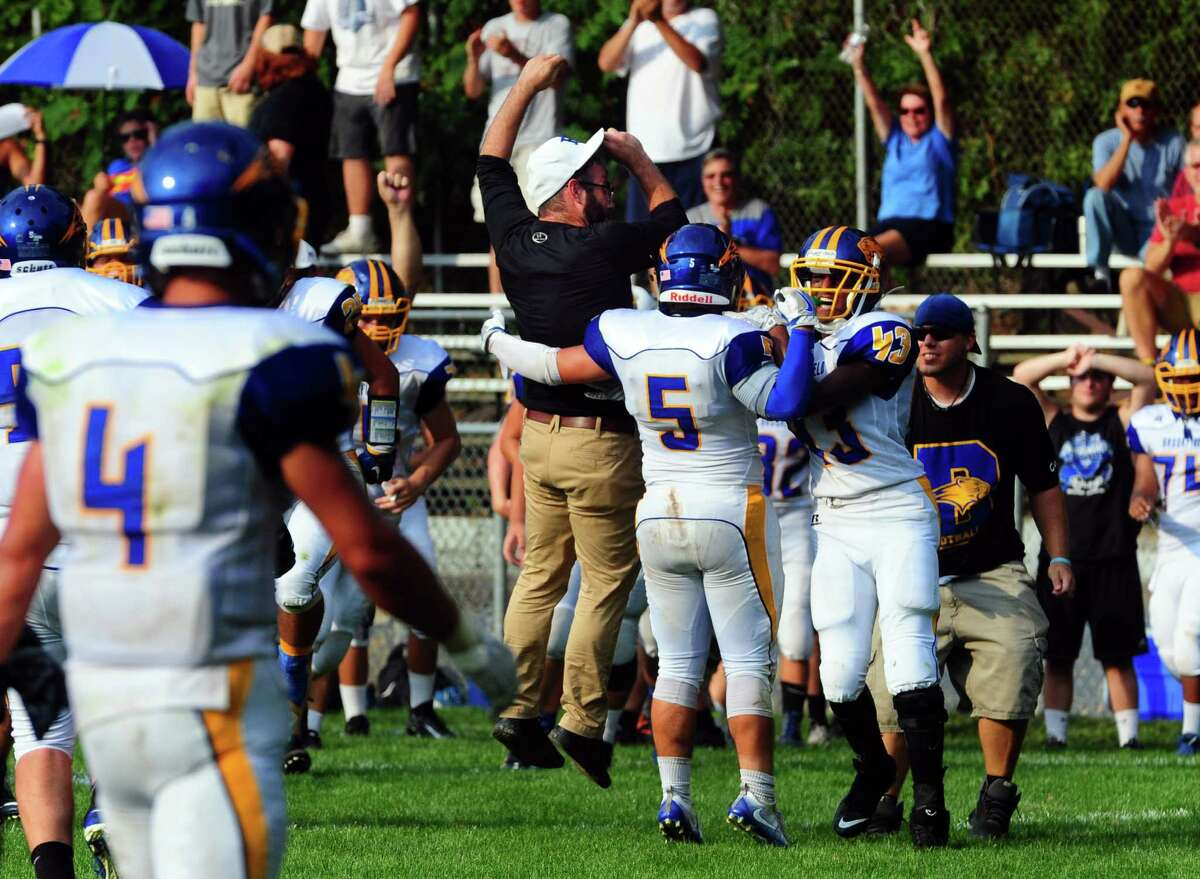 Brookfield celebrate its preventing Notre Dame from an upset in the final moments of football action in Fairfield, Conn. on Saturday Sept. 10, 2016. Final score 17-14.