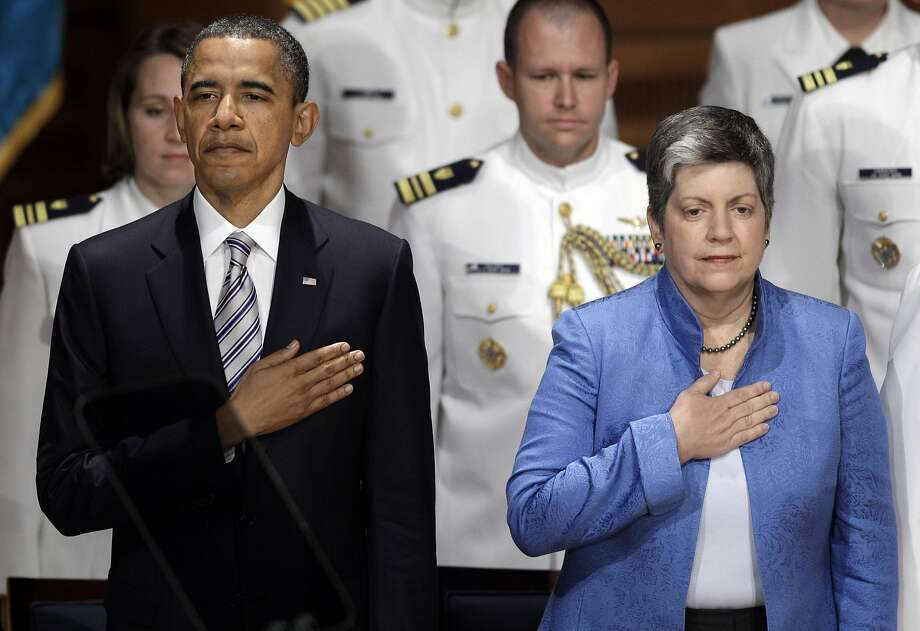 President Barack Obama and Director of Homeland Security Janet Napolitano during the playing of the National Anthem at the start of the 130th Coast Guard Academy Commencement in New London, Conn., Wednesday, May 18, 2011. (AP Photo/Stephan Savoia) Photo: Stephan Savoia, ST