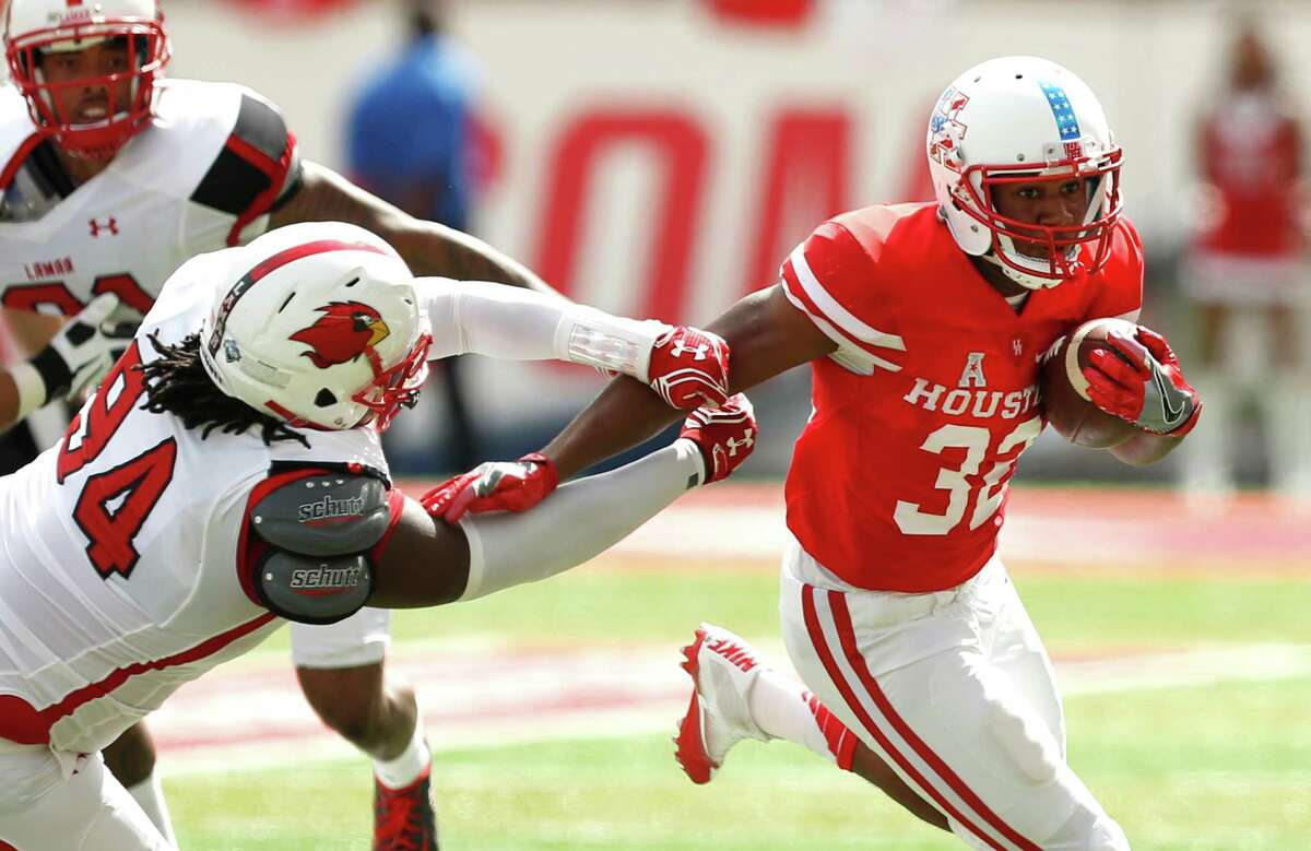 UH running back Kevrin Justice (32) and the Cougars trounced Lamar last week to move to 2-0. Click through the gallery to see where UH stands in this week's American Athletic Conference power rankings.