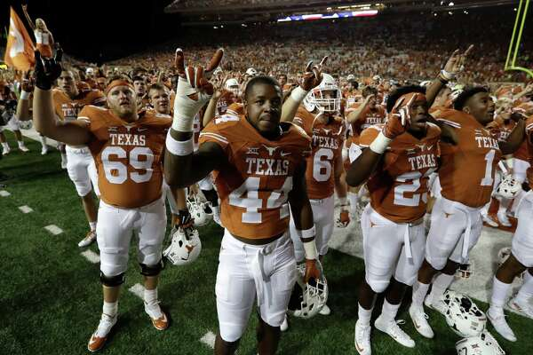 Texas players gather for the school song following a NCAA college football game against UTEP, Saturday, Sept. 10, 2016, in Austin. (AP Photo/Eric Gay)