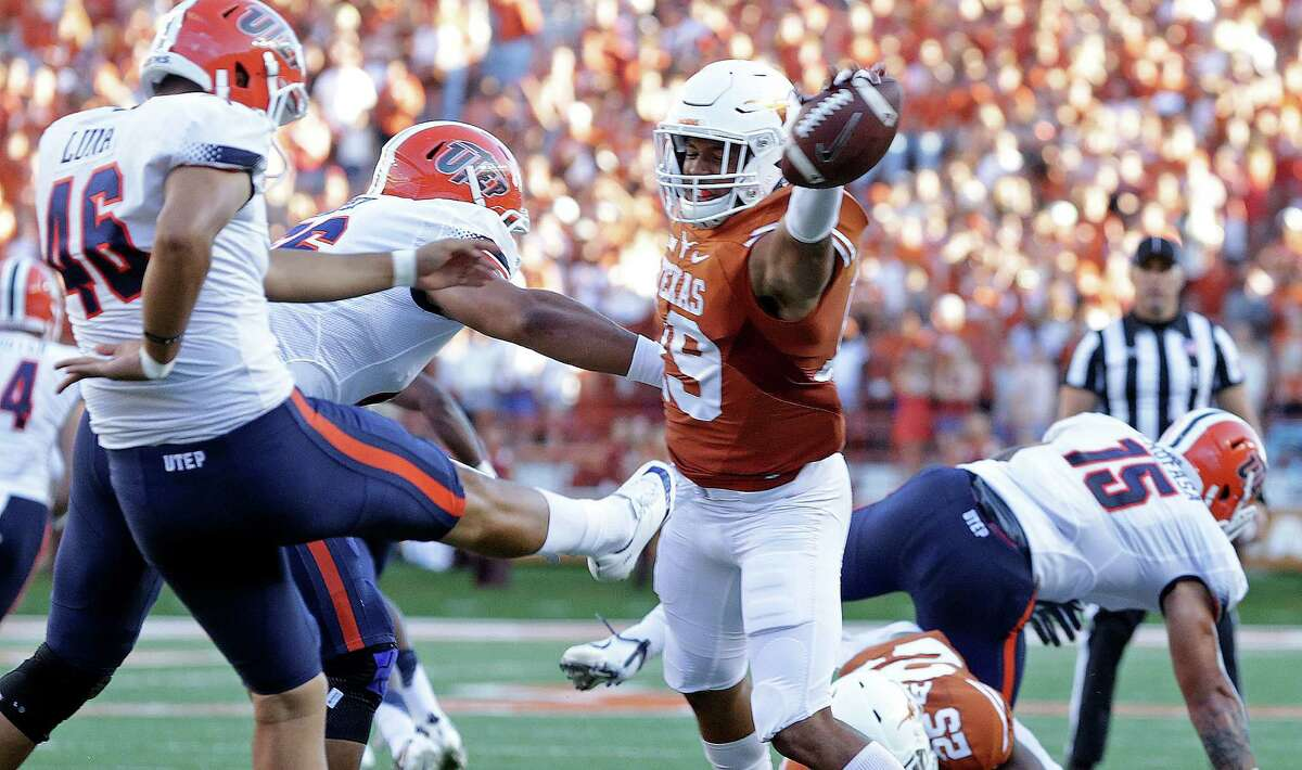 Brandon Jones blocks the punt of Alan Luna in the first half setting up a field goal for the Longhorns as Texas hosts UTEP at Royal-Memorial Stadium in Austin on Sept. 10, 2016.