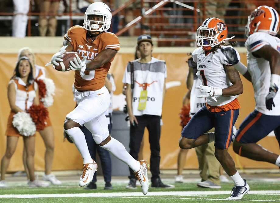 Longhorn wide receiver Dorian Leonard takes the ball in full stride for a touchdown the third quarter on a pass from Shane Buechele as Texas hosts UTEP at DKR Stadium in Austin  on September 10, 2016. Photo: TOM REEL, STAFF / SAN ANTONIO EXPRESS-NEWS / 2016 SAN ANTONIO EXPRESS-NEWS
