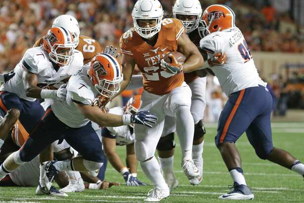 Chris Warren high steps away from the middle as Texas hosts UTEP at DKR Stadium in Austin  on September 10, 2016.
