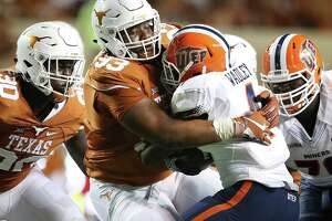 Longhorn lineman Paul Boyette wraps up Miner running back Quadric Wadley as Texas hosts UTEP at DKR Stadium in Austin  on September 10, 2016.