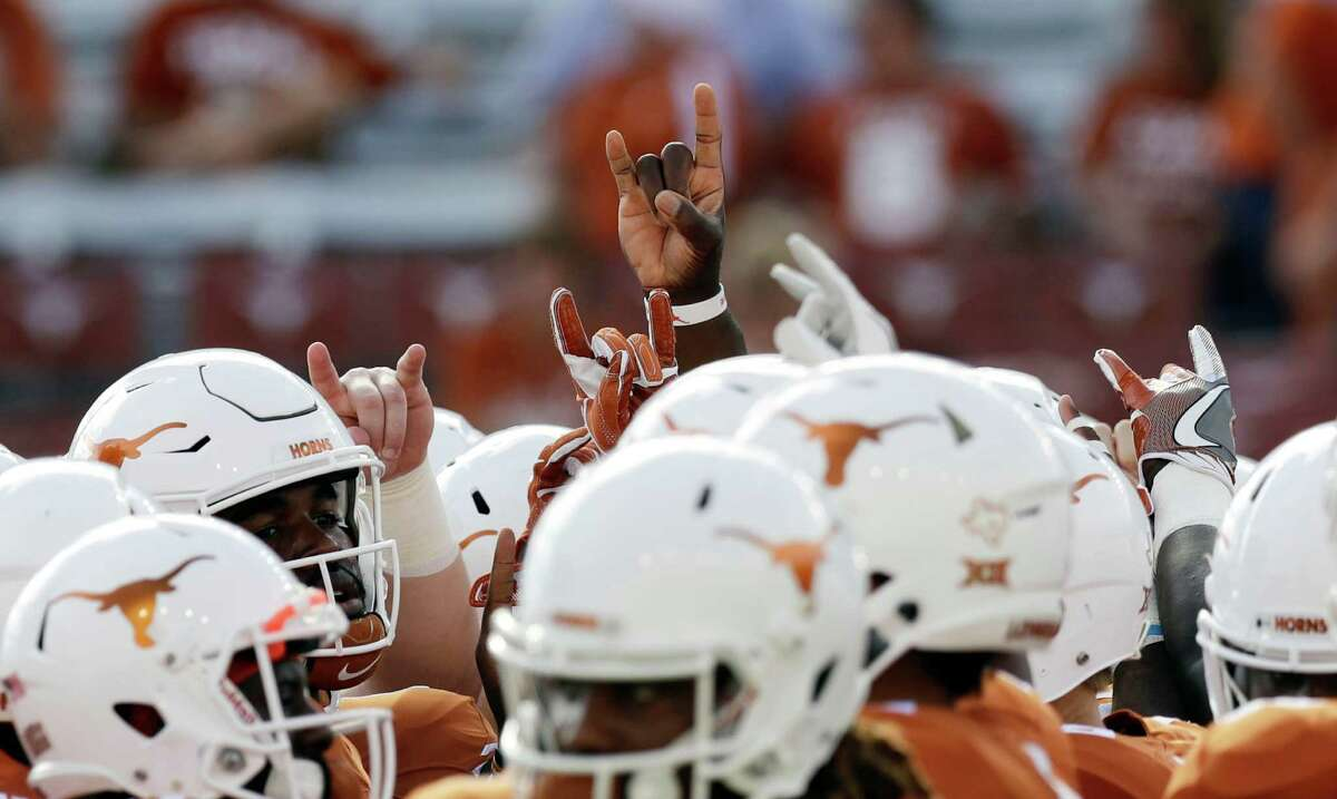 Texas players gather prior to a NCAA college football game against UTEP, Saturday, Sept. 10, 2016, in Austin. (AP Photo/Eric Gay)