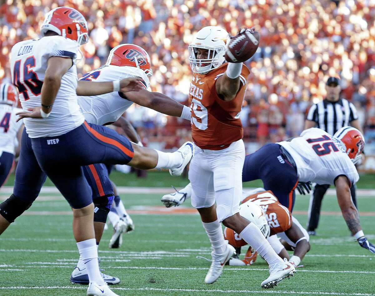 Brandon Jones blocks the punt of Alan Luna in the first half setting up a field goal for the Longhorns as Texas hosts UTEP at DKR Stadium in Austin on September 10, 2016.