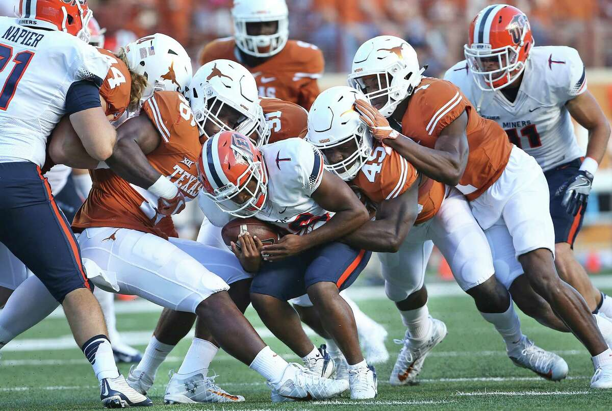 The Longhorn defense stifles receiver Walter Dawn at the line as Texas hosts UTEP at DKR Stadium in Austin on September 10, 2016.