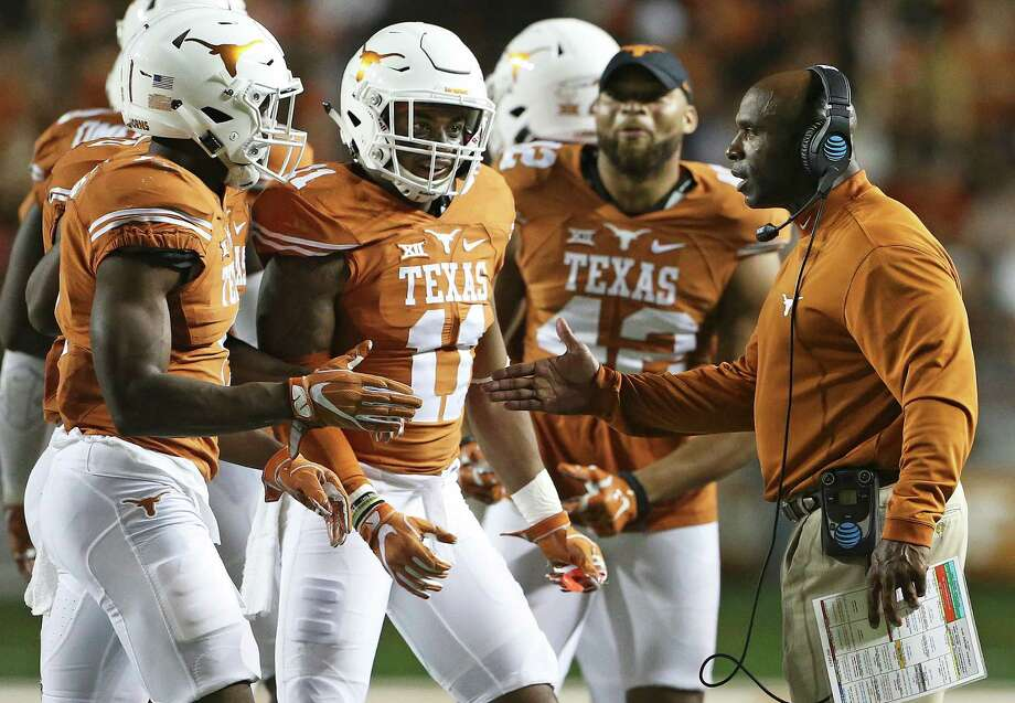 Charlie Strong congratulates his defense as Texas hosts UTEP at Royal-Memorial Stadium in Austin on Sept. 10, 2016. Photo: Tom Reel /San Antonio Express-News / 2016 SAN ANTONIO EXPRESS-NEWS