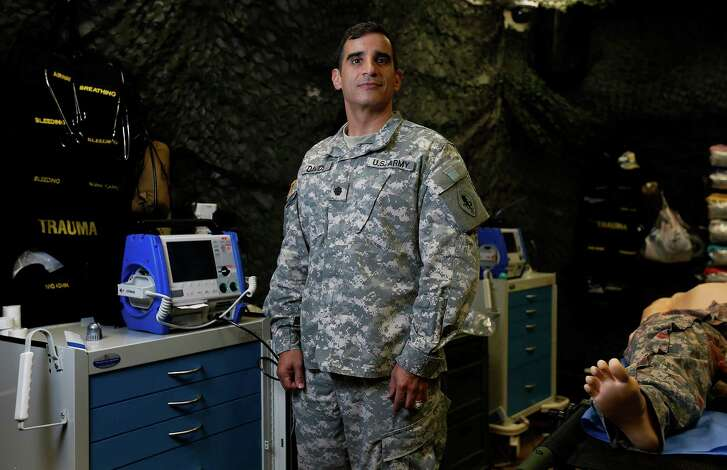 Lt. Col. Neil Davids has served in the U.S. Army since 9/11 and remain on duty on the 15th anniversary of the terrorist attacks in New York City. Davids is posted at the Army Medical Department Center and School at Joint Base San Antonio - Fort Sam Houston. (Kin Man Hui/San Antonio Express-News)