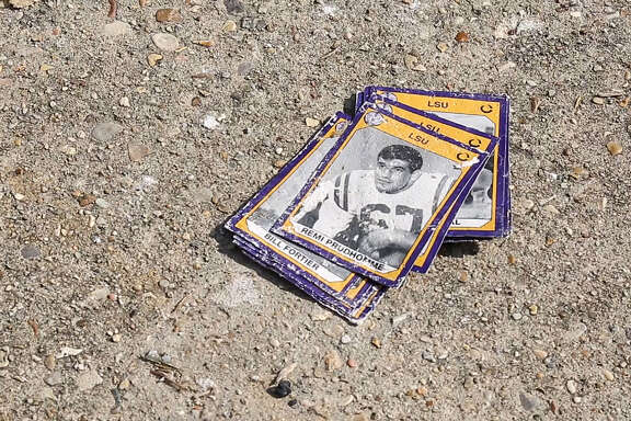 LSU memorabilia damaged by floodwaters are seen Friday, Sept. 9, 2016, in Baker, La.