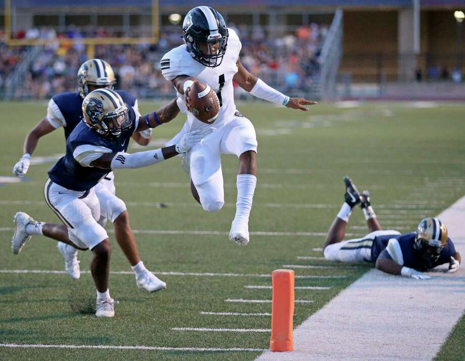 Steele's Xavier Martin leaps for a touchdown around O'Connor's Zaire Taylor during first half action Saturday Sept. 10, 2016 at Farris Stadium. Photo: Edward A. Ornelas, Staff / San Antonio Express-News / © 2016 San Antonio Express-News