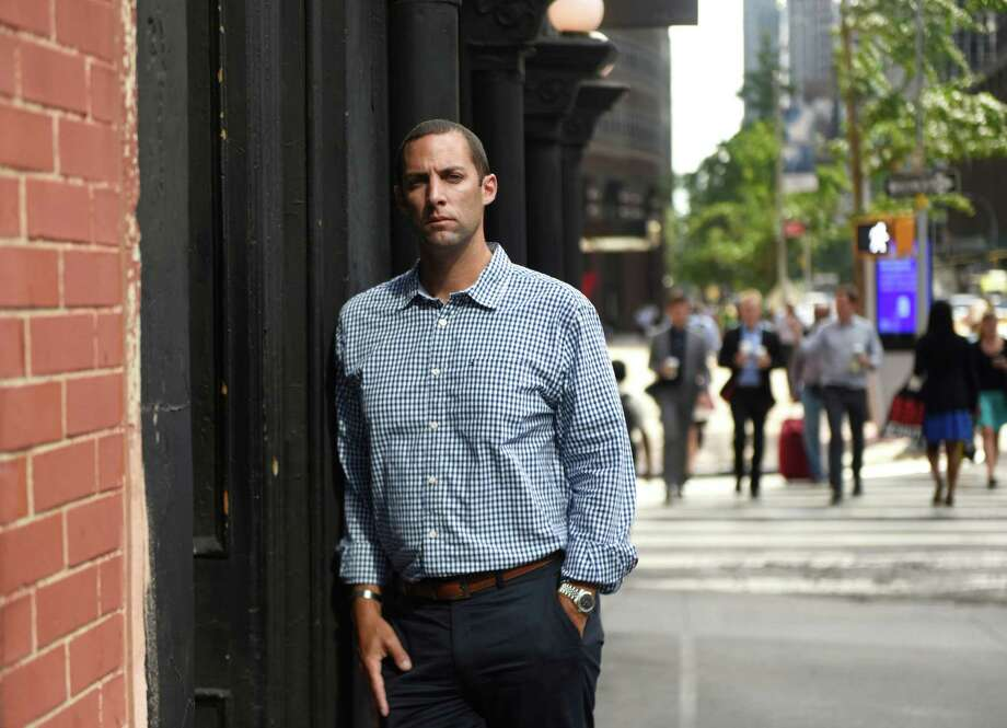Michael Pascuma poses in midtown Manhattan recently. Pascuma lost his father, a successful stock broker at the American Stock Exchange also named Michael, in the World Trade Center attacks on Sept. 11, 2001. Michael graduated from Sacred Heart University in 2003 with a double major and two minors. He now works as the chief operating officer and head of business development at Long Island-based Solve Advisors. Photo: Tyler Sizemore / Hearst Connecticut Media / Greenwich Time