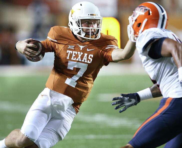 Shane Buechele takes a cut on a run as Texas hosts UTEP at Royal-Memorial Stadium in Austin on Sept. 10, 2016.