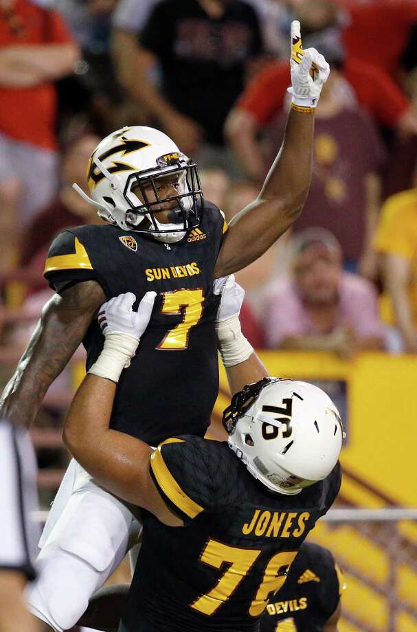 Arizona State's Kalen Ballage (7) celebrates a touchdown against Texas Tech with Sam Jones, right, during the first half of an NCAA college football game Saturday, Sept. 10, 2016, in Tempe, Ariz. (AP Photo/Ross D. Franklin) Photo: Ross D. Franklin, Associated Press / Copyright 2016 The Associated Press. All rights reserved.