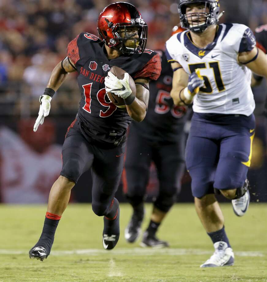 San Diego State running back Donnel Pumphrey heads to the end zone for a touchdown in front California's Cameron Saffle during the first half of an NCAA college football game Saturday, Sept. 10, 2016, in San Diego.  Photo: Don Boomer, Associated Press