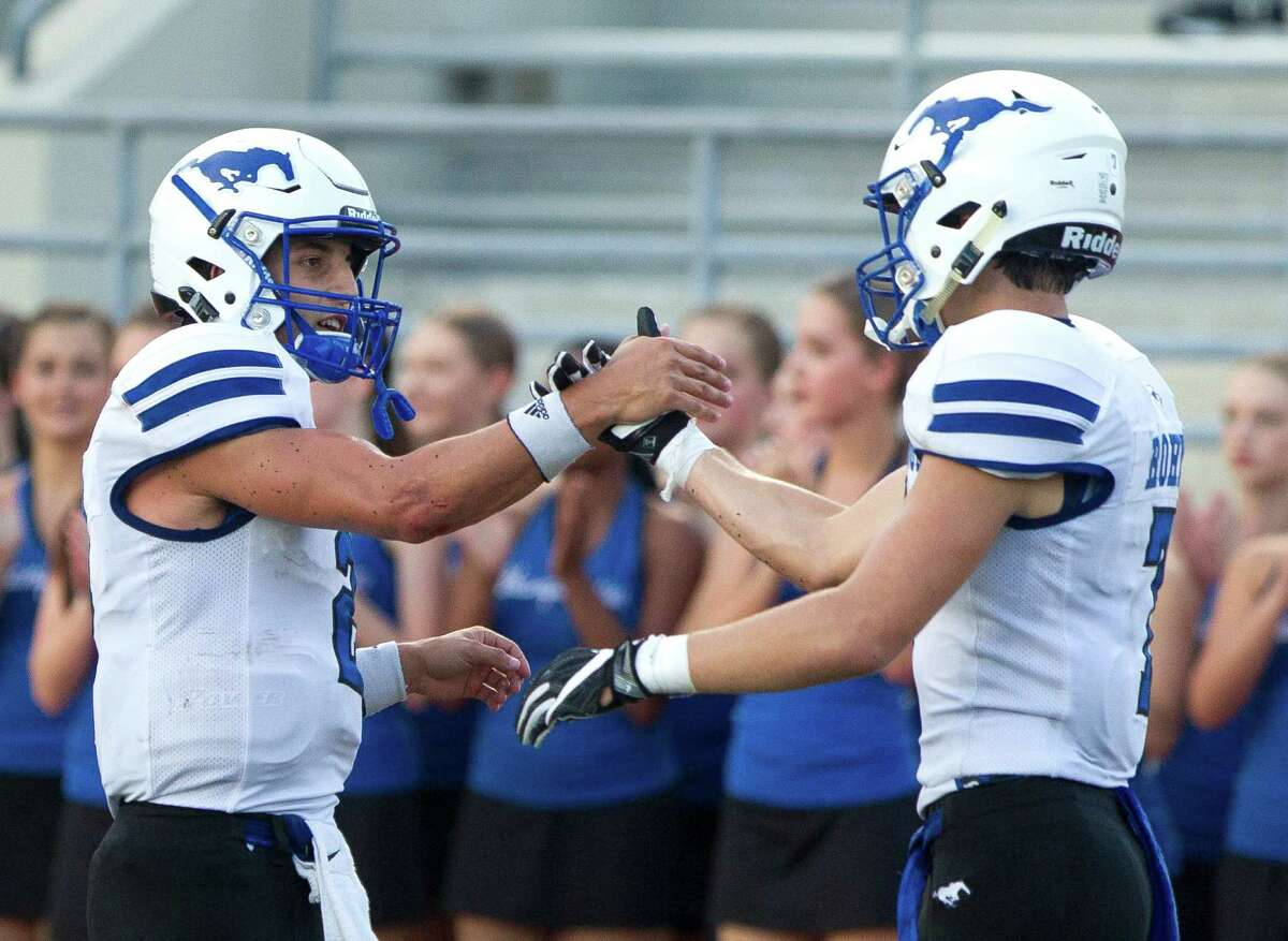 Friendswood quarterback Tyler Page, left, celebrates with wide receiver Reed Roher after throwing a 56-yard touchdown pass to wide receiver Nick Swaney during the second quarter of a non-district high school football game Saturday, Sept. 10, 2016, at Turner Stadium in Humble.