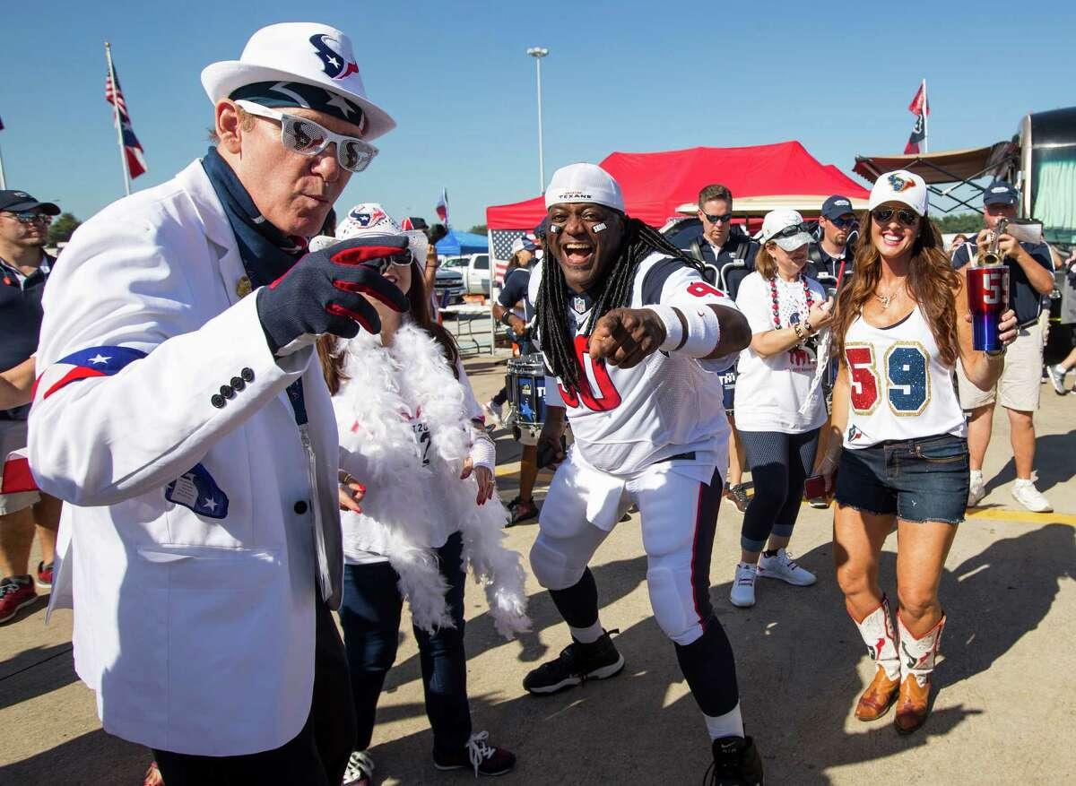 Houston Texans fans dance outside NRG Stadium before the NFL season opener between the Texans and Chicago Bears on Sunday, Sept. 11, 2016, in Houston.