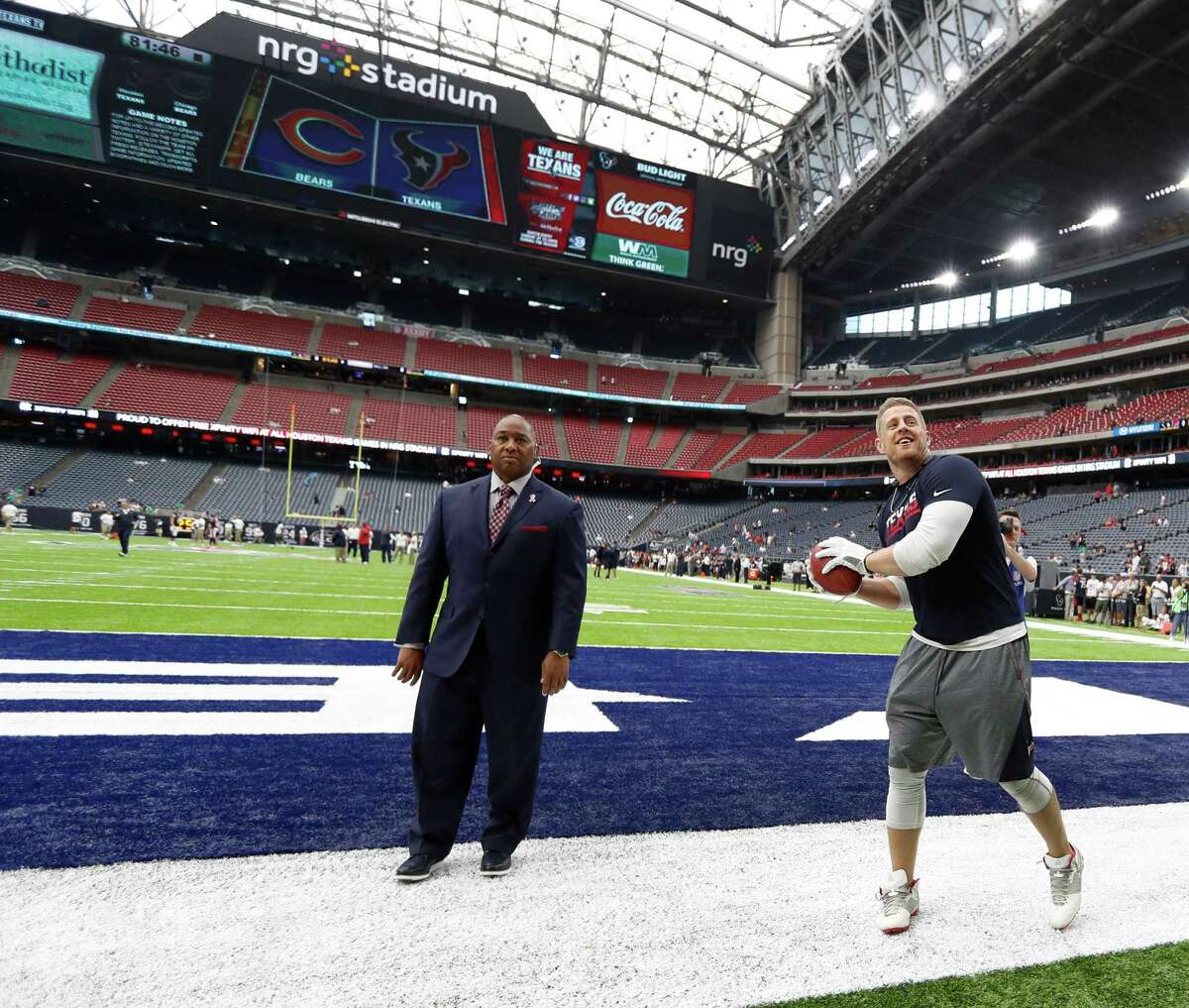 Houston Texans defensive end J.J. Watt (99) tosses a football into the stands as he played catch with fans during warmups before the start of an NFL game at NRG Stadium,Sunday, Sept. 11, 2016 in Houston.