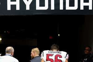 Houston Texans inside linebacker Brian Cushing (56) leaves the field after an injury during the first quarter of an NFL game at NRG Stadium,Saturday, Jan. 1, 2016 in Houston.