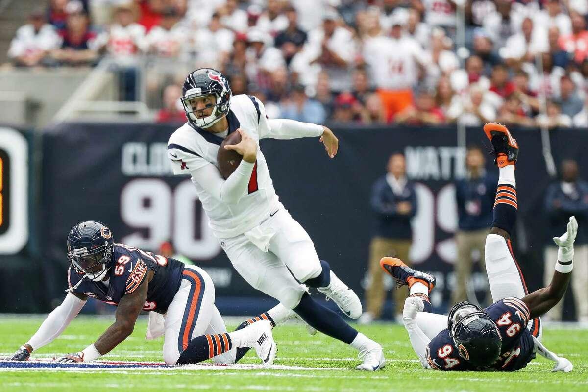 Houston Texans quarterback Brock Osweiler (17) runs past Chicago Bears linebacker Danny Trevathan (59) and outside linebacker Leonard Floyd (94) during the first quarter of an NFL game at NRG Stadium,Sunday, Sept. 11, 2016 in Houston.