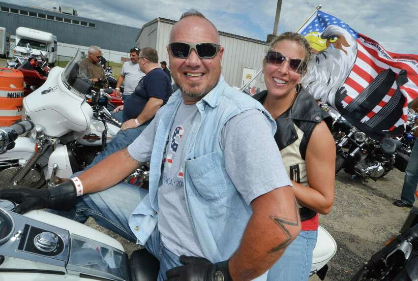Norwalk's Dan Mariano and wife Heidi get seated for their 5th United Ride at Norden Park as thousands of motorcyclists ride in the CT United Ride, Connecticut?'s largest 9/11 tribute ?- a 60 mile motorcade through Faifield County starting at Norden Park in Norwalk Conn. on Sunday September 11, 2016 and ending at Seaside Park in Bridgeport