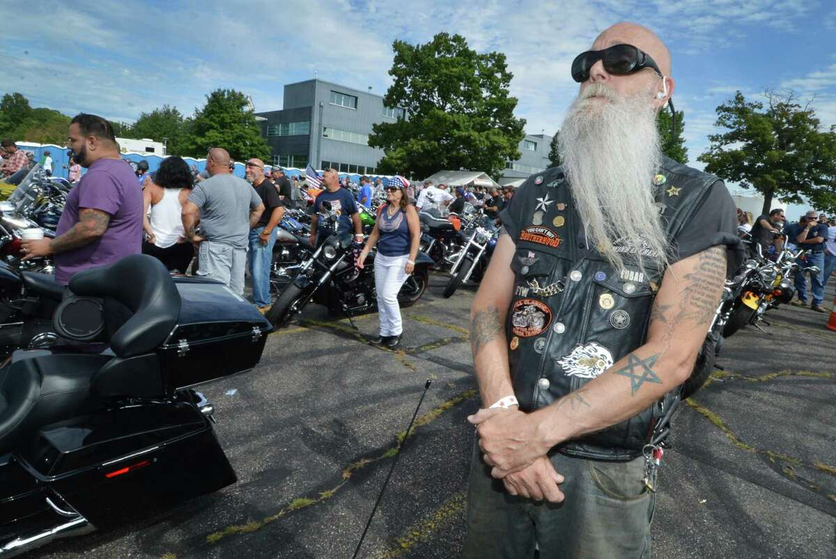 Seymour's Wayne Gwazda listen to speakers while waiting to set off in the CT United Ride, Connecticut?'s largest 9/11 tribute ?- a 60 mile motorcade through Faifield County starting at Norden Park in Norwalk Conn. on Sunday September 11, 2016 and ending at Seaside Park in Bridgeport