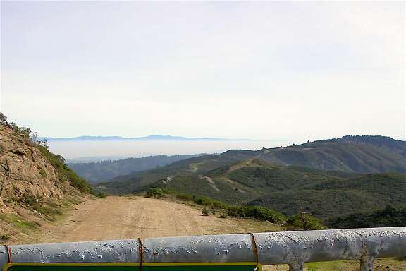 Paradise gated: At the summit of Montara Mountain, hikers will find the service road gated that leads into the 23,000-acre Crystal Springs Watershed on the Peninsula