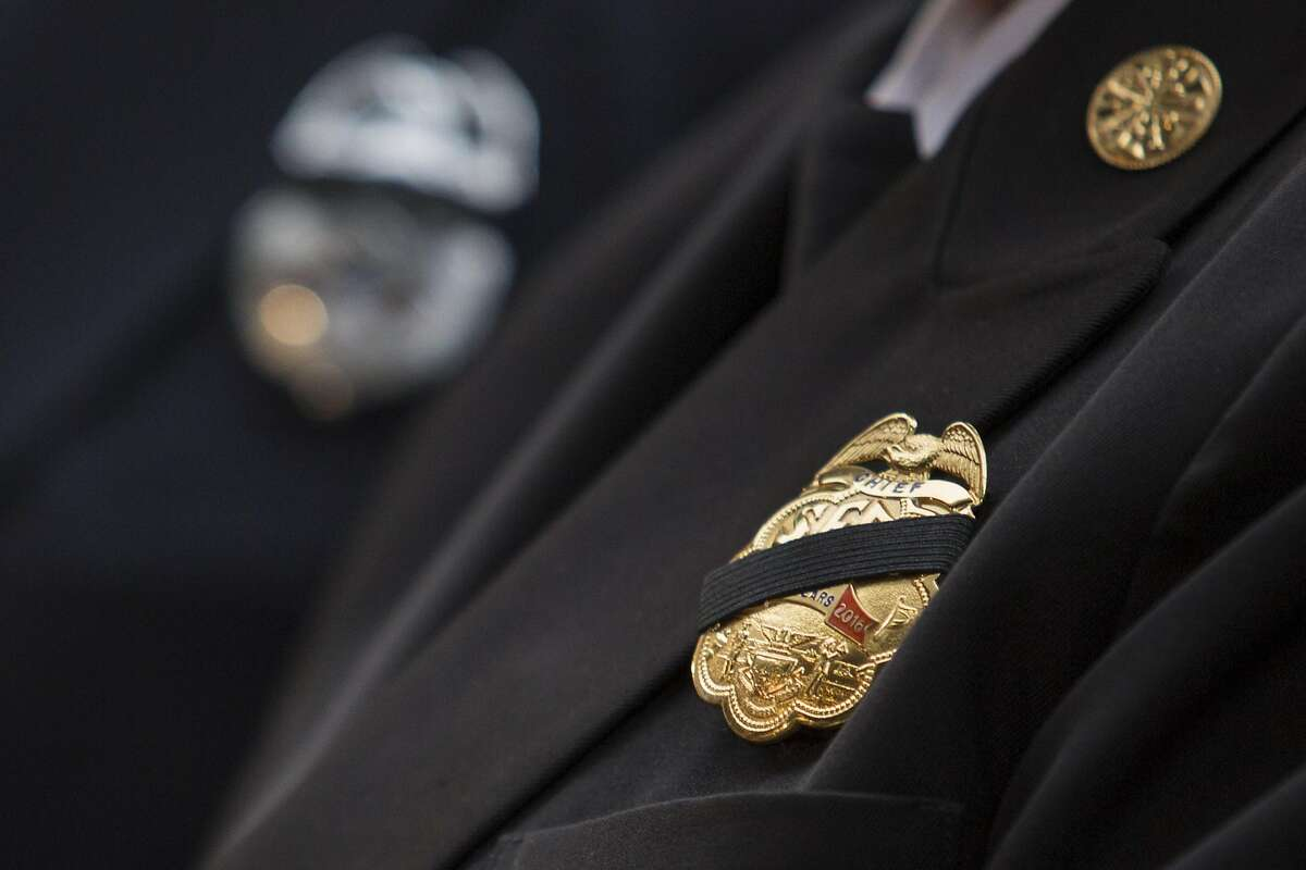 FILE-- A black mourning band covers the badge of Joanne Hayes-White, the San Francisco Fire Department chief, during a 9/11 memorial, on Sunday, September 11, 2016 in San Francisco, Calif.