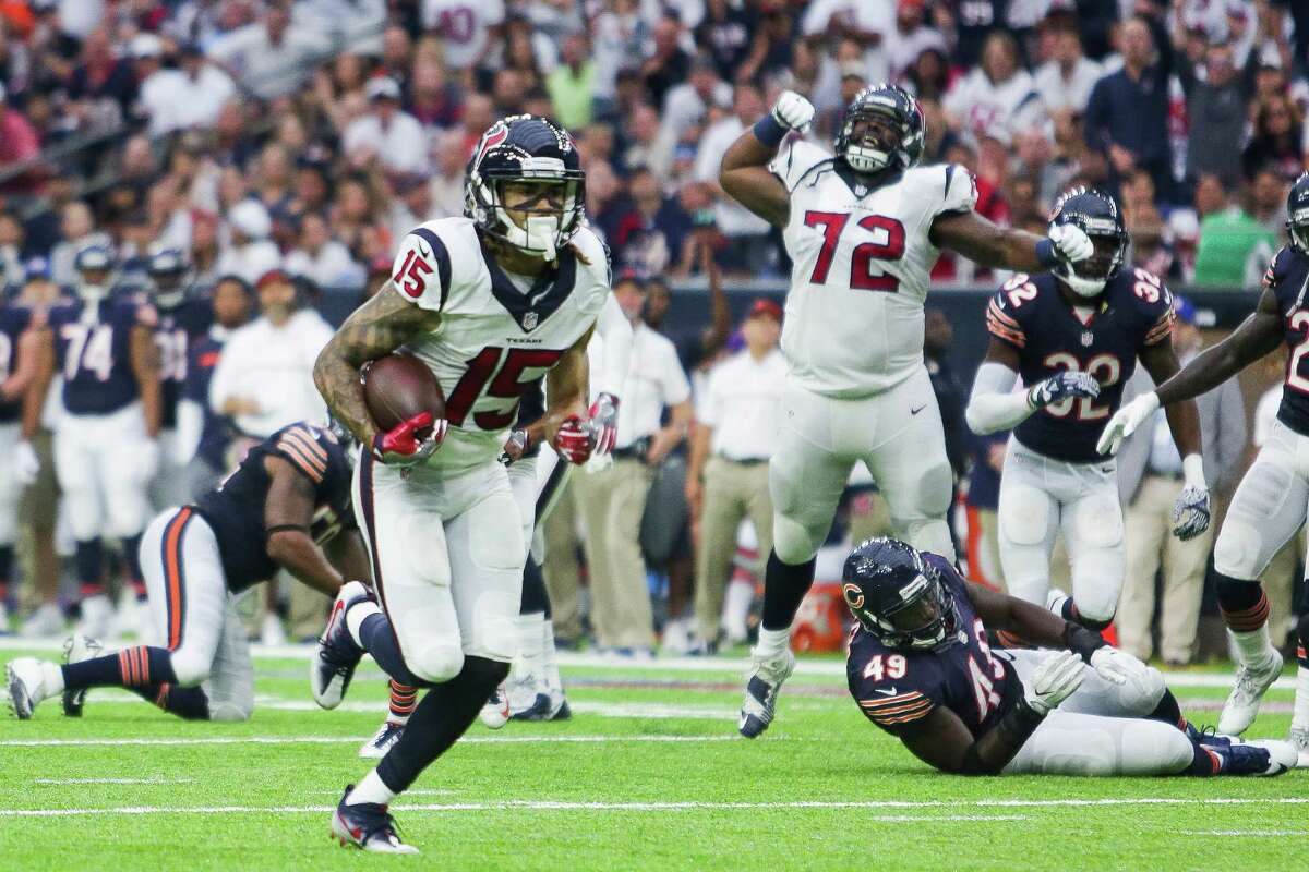 Houston Texans tackle Derek Newton (72) cheers in the background as wide receiver Will Fuller (15) runs for a touchdown during the second half of an NFL football game at NRG Stadium Sunday, September 11, 2016 in Houston.