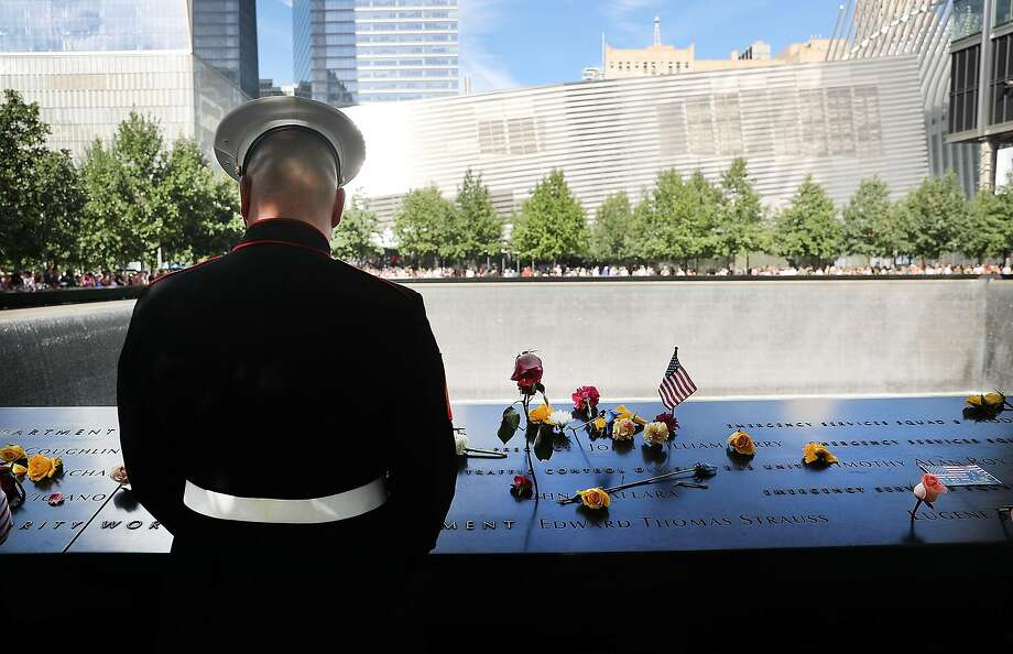 NEW YORK, NY - SEPTEMBER 11:  A U.S. Marine pauses at one of the pools at the National September 11 Memorial following a morning commemoration ceremony for the victims of the terrorist attacks fifteen years after the day on September 11, 2016 in New York City. Throughout the country services are being held to remember the 2,977 people who were killed in New York, the Pentagon and in a field in rural Pennsylvania.  (Photo by Spencer Platt/Getty Images) Photo: Spencer Platt, Getty Images