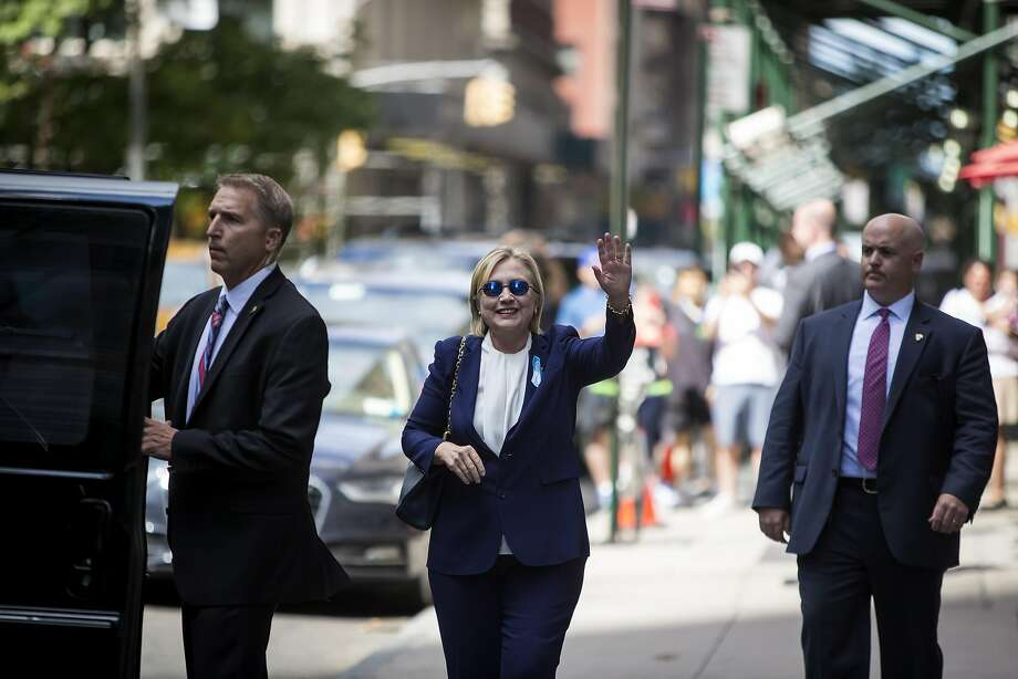 Hillary Clinton waves outside her daughter's New York City home after she had left a 9/11 event. Photo: ERIC THAYER, NYT