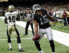 Oakland Raiders wide receiver Michael Crabtree (15) celebrates his touchdown reception in front of New Orleans Saints cornerback Ken Crawley (46) in the second half of an NFL football game in New Orleans, Sunday, Sept. 11, 2016. (AP Photo/Bill Feig)
