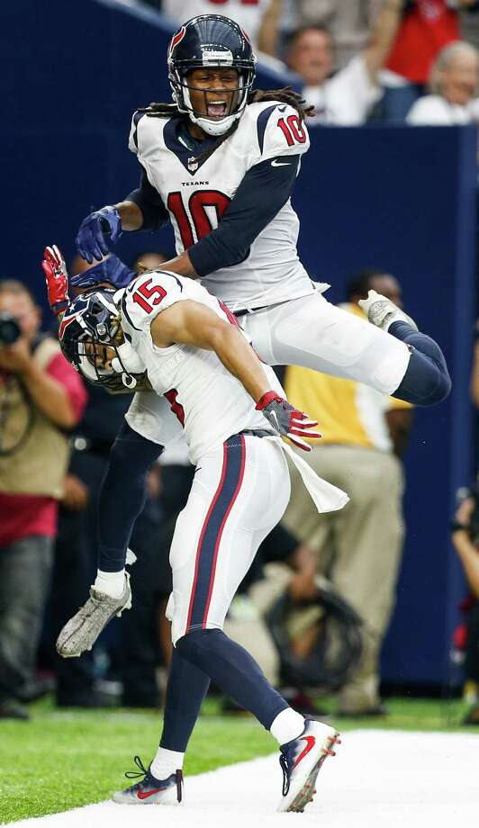 These Yeezy cleats he wore in Sunday's victory over the Bears made Texans receiver DeAndre Hopkins about $6,000 lighter in the wallet. Photo: Brett Coomer, Houston Chronicle / © 2016 Houston Chronicle