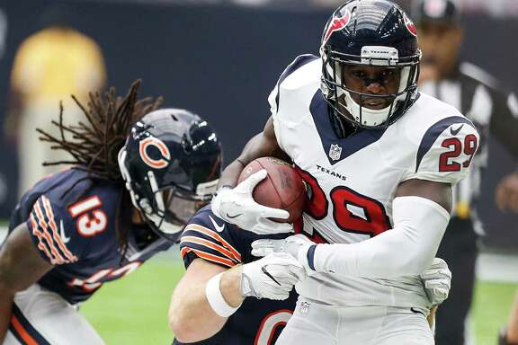 Houston Texans free safety Andre Hal (29) returns an interception of a pass by Chicago Bears quarterback Jay Cutler during the third quarter of an NFL football game at NRG Stadium on Sunday, Sept. 11, 2016, in Houston.