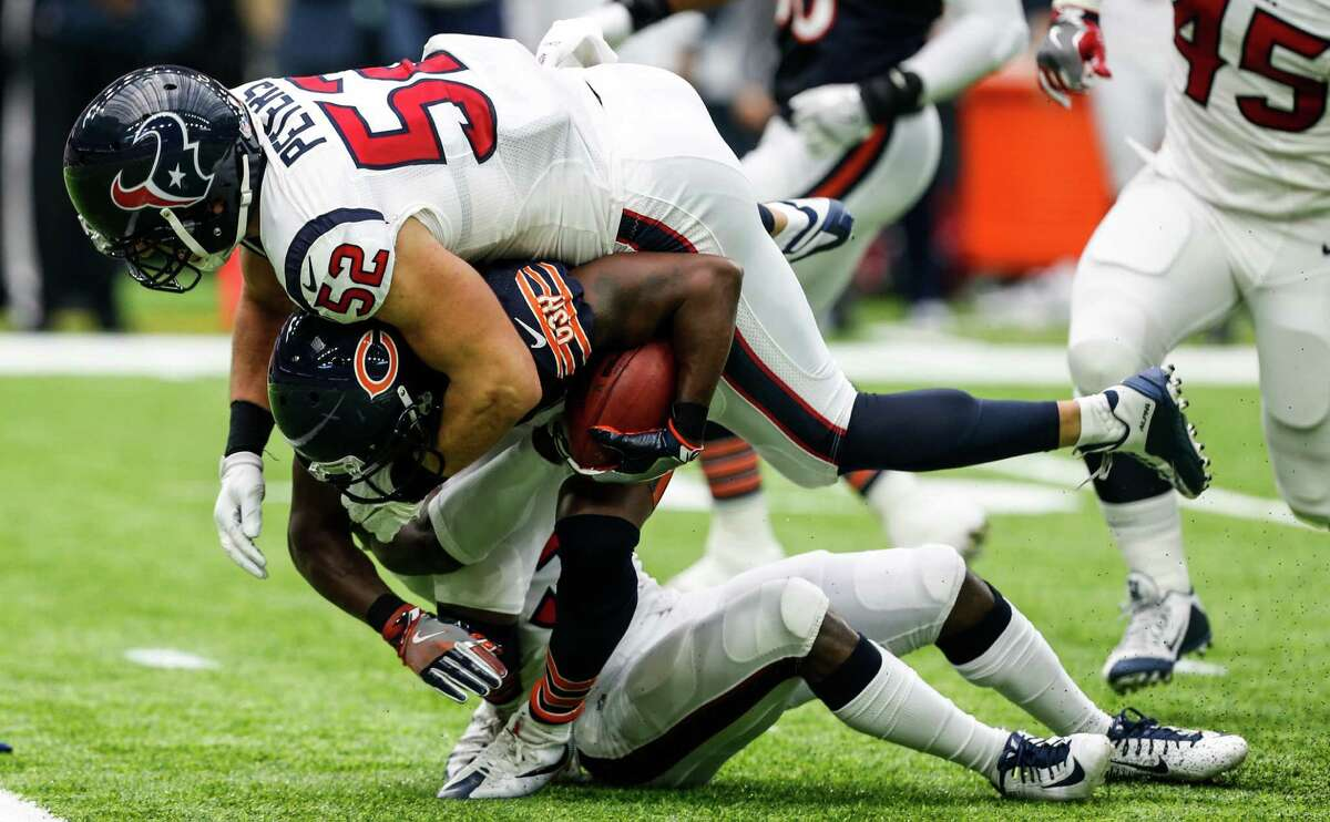 Houston Texans linebacker Brian Peters (52) and defensive back Charles James (31) stop Chicago Bears wide receiver Eddie Royal (19) on a punt return during the second quarter of an NFL football game at NRG Stadium on Sunday, Sept. 11, 2016, in Houston.