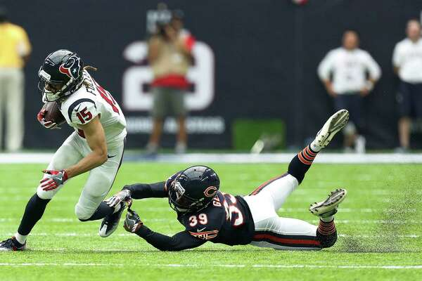 Houston Texans wide receiver Will Fuller (15) gains yardage against Chicago Bears cornerback Jacoby Glenn (39) during the third quarter of an NFL game at NRG Stadium,Sunday, Sept. 11, 2016 in Houston.