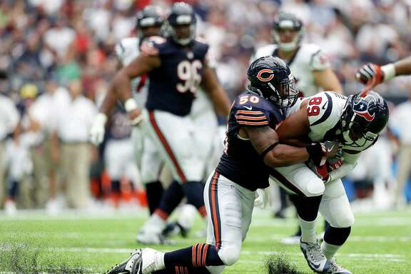 Houston Texans tight end Stephen Anderson (89) gains yardage against Chicago Bears linebacker Jerrell Freeman (50) during the third quarter of an NFL game at NRG Stadium,Sunday, Sept. 11, 2016 in Houston.