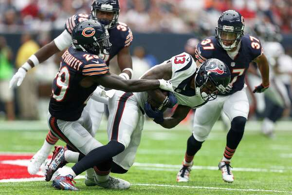 Houston Texans wide receiver Braxton Miller (13) hangs onto the ball as he gets brought down by Chicago Bears strong safety Harold Jones-Quartey (29) during the second quarter of an NFL game at NRG Stadium,Sunday, Sept. 11, 2016 in Houston.